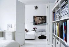 Inspiring Scandinavian Home Interior Designs. Nice White Modern Swedish Home Interior Design Style Completed with Awesome Bookcase, Cozy Study Space, High Doors, Soft White Sofa, and Cool Unique Floor Lamp Design Living Room Scandinavian, Scandinavian Home Interiors, Scandinavian Style, White Interiors, Scandinavian Garden, Swedish Style, White Interior Design, Contemporary Interior Design, Luxury Interior