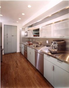 galley kitchen with silver pine cabinetry and stainless steel countertops Home Kitchens, Contemporary Kitchen, Kitchen Design Styles, Stainless Steel Kitchen Countertops, Kitchen Decor, Kitchen Countertops, Kitchen, Retro Kitchen, Kitchen Style