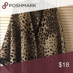 Fashionable Cape Wrap yourself in this stylish and comfy animAl print wrap 100% soft acrylic.  I am a non-smoker. ENJOY FASHION! Jackets & Coats