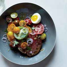 Salty anchovy dressing and pickled shallots are a great way to add savory accents to summer's sweetest, juiciest tomatoes.