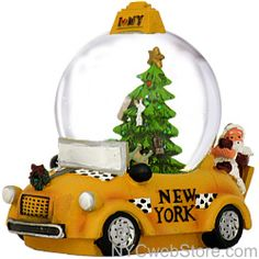 "Santa's New York Taxi   Christmas Snow Globe  What's not to love about this 2-in-1 gift?  You get a an antique taxi figurine with Santa and a Teddy Bear riding in back and a beautifully decorated Christmas Tree snow globe nestled in the taxi.  The Empire State Building, Statue of Liberty and Brooklyn Bridge are featured as ornaments on the tree.  Also, the iconic I Love NY logo is featured on top of the globe!  Measures 4""H x 4.5""L  http://www.nycwebstore.com/detail.aspx?PRODUCT_ID=KA-J3230"