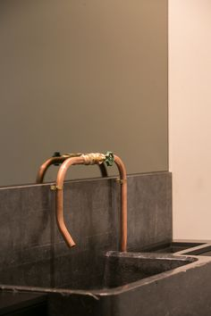 Sink and faucet for restaurant Va et Vient by chef Matthias Speybrouck, interior by Ensemble www.e-1.be, copper subframe, concrete floor and white washed walls, Friso Kramer chairs, Handle Pendant by Josie Morris, Kortrijk, Belgium
