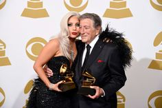 Lady Gaga and Tony Bennett pose in the press room with the award for best traditional pop vocal album for 'Cheek to Cheek' at the 57th annual Grammy Awards in Los Angeles on Sunday, Feb. 8, 2015. Photo by Chris Pizzello of Invision.