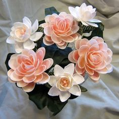I would love to decorate with these seashell flowers!!