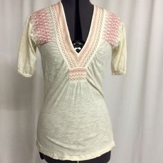 Anthropologie cotton knit top. Size small Cream cotton top with multi colored stitching on the bust and shoulders. No flaws Anthropologie Tops Blouses