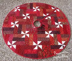 I finished a new tree skirt out of a Christmas fabric strip set I had. I had to wait for Builder Bob to get our little skinny tree out of the storage building and when I brought it in the house…..the cats went crazy!  I am entering this in the 2012 Christmas quilt show...Read More »