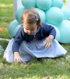 The young princess look intrigued as she spotted some bubbles on the grass.
