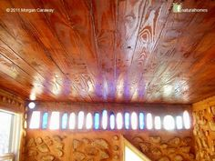 A cordwood bathhouse. A row of coloured bottles let in light. I like this as an idea in a garden wall.   (www.a-sustainable-life.blogspot.com)