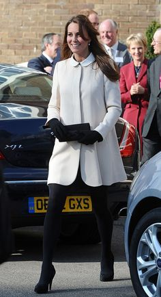 March 2013 – The Duchess wore a white Redgrave Goat collarless coat over a dress from Topshop as she visited the headquarters of Child Bereavement