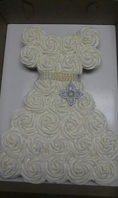 27 cupcakes create this wedding dress shower cake.