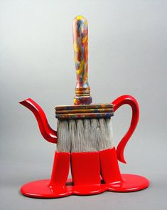 paintbrush with red paint.......teapot