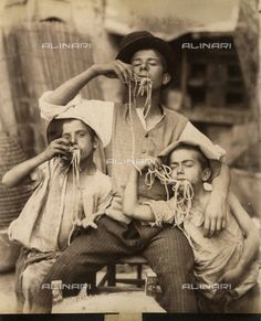 Title: A group of children who eat the spaghetti, Credits: Fratelli Alinari Museum Collections, Florence