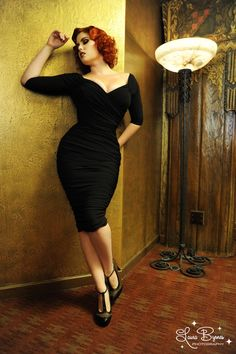 Monica Dress in Black Matte Jersey Knit - The Monica is a wonder of a wiggle!  The beautiful crossover bustline features soft, clear elastic to hold it to your skin and allows the sleeves to sit slightly off-shoulder. The fabric is a unique matte knit that will not pill, resists wrinkles, and has beautiful drape and stretch.