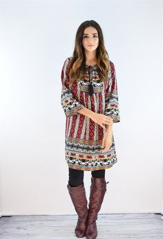"""This luxurious tunic is a comfortable classic. Pair this with tall boots and your favorite jeans!  Fits true to size model is size 4, 5'6"""" tall and she wears size small.SIZE:(Fits true to size in relaxed)Small (0-4)Medium (6-8)Large (10-12)95% rayon5% spandexMade in USA"""