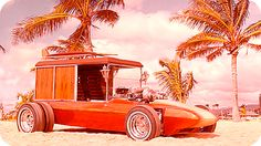 """""""SURF WOODY""""  Designed to haul a a motorized surfboard on the roof, it has a 105 inch wheel base and a super wide tread – 66 inches in the front, 87 inches inches on the rear where there are dual Mickey Thompson drag racing slicks which will enable the car to plow through deep sand into the best surfing areas"""