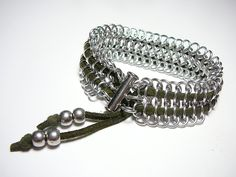 Robust chain maille bracelet intertwined with a suede cord, via Etsy.