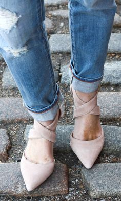Neutral suede mid heel with sweeping crossed straps and a pointed toe