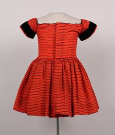 Date Made: 1850-55  Description:  Dress; boy's, red wool with black print accented with black velvet band on short sleeve.