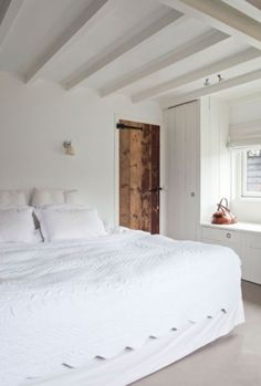 """This lovely white bedroom in from our feature """"Restored Splendour"""""""