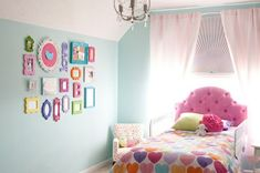 22 Cool Toddler Girl Room Ideas- I would buy cheap frames and wooden letters and paint over them to match the room.