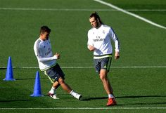 Gareth Bale and Mateo Kovacic of Real Madrid warm-up during the Real Madrid training session ahead of the La Liga match between Real Madrid and Barcelona at Valdebebas training ground on November 2015 in Madrid, Spain Fc Barcelona, Real Madrid And Barcelona, Real Madrid Training, Gareth Bale, Sports Betting, November, Kicks, Spain, Soccer