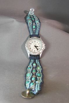 Another early watch band done in the herringbone stitch.