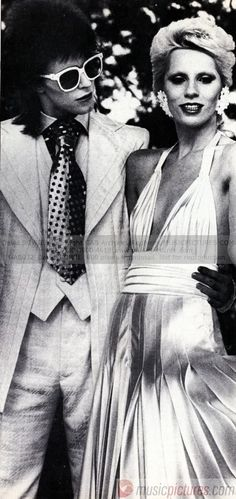david bowie with angela bowie.  i want that dress.