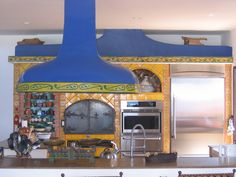 Kitchen with wood-burning pizza oven and free-hanging hood