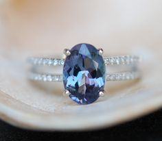 beautiful ring! Love the idea of Tanzanite for a center stone - its a gorgeous blue-purple color and very shiny!