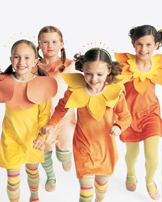 """Make a sunny bundle of daisies, tulips, and sunflowers. These friends wear felt-petal collars and """"pollen"""" headdresses topped with stickers. Velour dresses and bright tights bring it all together without a single stitch."""
