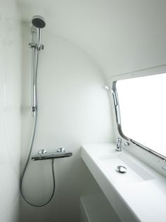 Beautifully minimalist Airstream bathroom.  From:  arcairstreams.co.uk