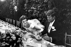 Senator John Kennedy and his bride, Jacqueline Bouvier Kennedy, smile during their wedding reception, September 12, 1953, in Newport, Rhode Island.