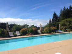 Poolside paradise at Ventana Inn, complete with views of Big Sur redwoods and the Pacific Ocean breeze.