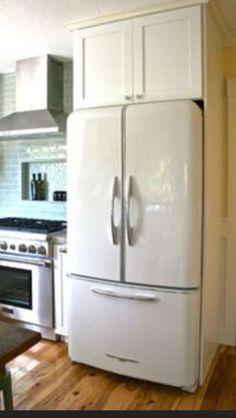 This is the white fridge we are getting...moving it to the wall where the hutch currently is