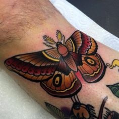 Neotraditional style butterfly tattoo on the right shin.Done by Matt Webb