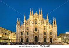Night view of famous Milan Cathedral (Duomo di Milano) on piazza in Milan, Italy with stars on the blue dark sky