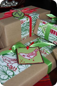 Brown craft paper, strip of wrapping paper, skinny ribbons... Perfect for our tree! Can't wait to start buying and wrapping :)
