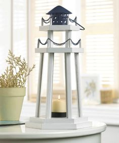 Nautical Lighthouse Candle Lantern: http://www.completely-coastal.com/2016/04/nautical-coastal-candle-lanterns-wood.html Lovley Lantern made from Wood.