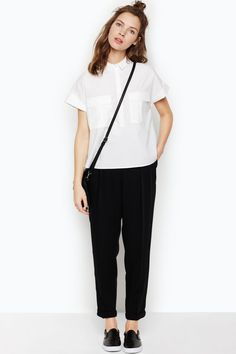 Take a stroll in high end leisure land with these essential trousers! To the left you will notice the gentle front pleating, a slim tailored leg with cuffed bottom, and discreet zip meets button closure. We hope you enjoy your stay!