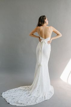 A high-neck, low-back wedding dress with a ribbed crepe top, built-in ribbon belt, and hidden slit skirt. Kloof by Laudae available at The Bridal Studio in Salt Lake City. Sheath Wedding Gown, Bridal Wedding Dresses, Formal Wedding, Wedding Ideas, Wedding Hair, Lace Wedding, Different Dresses, Lace Mermaid, Boho