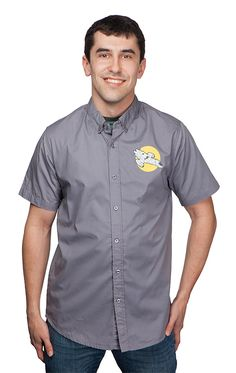 We thought there was a distinct lack of Serenity-adorned button up shirts in the marketplace today. So we set out to remedy that. This grey cotton shirt with short sleeves has Serenity screenprinted on the chest. Right over your heart. As it should be.