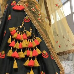 The ultimate list of gorgeous Lehenga and Blouse Latkan designs that are ruling the internet. From tassels to pom-pom designs, choose not just one but more. Saree Tassels Designs, Lehenga Designs, Indian Dresses, Indian Outfits, Pakistani Dresses, Indian Attire, Indian Wear, Indian Designer Wear, Textiles