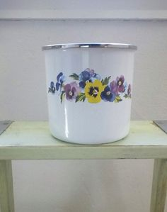 Vintage Enamelware Canister, Flower Tin, 70s Pansy Kitchen Storage by GMI by Gardenage on Etsy https://www.etsy.com/listing/177235107/vintage-enamelware-canister-flower-tin