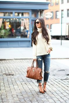 Kat Tanita of With Love From Kat wears a J. Crew Collection cream turtleneck with Rich & Skinny boyfriend jeans and Schutz heels for a cozy fall look.