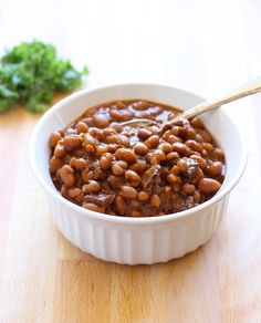 Best-Ever Slow-Cooker Baked Beans. I'd change a few of the ingredients but this looks/sounds really good and easy to make.