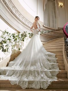 Such a long and stunning lace train on this @moonlightbridal wedding dress.
