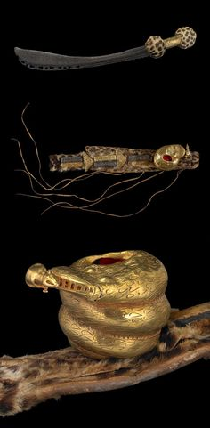 Africa   State sword (afena, Mpomponsuo) with curved cast iron blade. The wooden hilt which are covered with leopard skin. Sheath (boha) is made of leopard skin. The lost wax cast hollow gold sword ornament (abosodee) depicts a coiled snake, (probably a python) gripping an antelope (possibly a dyker (otwe) in its jaws   Asante region, Ghana   19th century      {13.6}