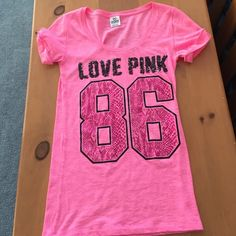 Victoria's Secret Tee Hardly ever worn. In excellent condition. Size XS. Bubble-gum pink. PINK Victoria's Secret Tops Tees - Short Sleeve