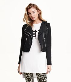 Biker jacket in imitation leather with a drawstring hood, lapels, and sleeves in sweatshirt fabric. Quilted sections at shoulders, diagonal zip at front, snap fasteners on lapels, and three pockets with zip. Jersey lining.