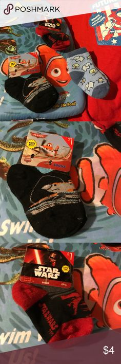 NWT 2 or Disney Planes Star Wars 1 used socks 1-5 Bundle has 2 new with tags and 1 slightly used infant boys pairs of socks. Disney Planes black socks and Disney Star Wars red, black and gray socks are new, have safety ties and fits shoes 1-5. Sick sizes are 4.5-5. Blue Disney elephant socks my grandson wore. New socks shell 97% polyester 2% spandex 1% rubber. Lining 100% nylon. Disney Accessories Socks & Tights